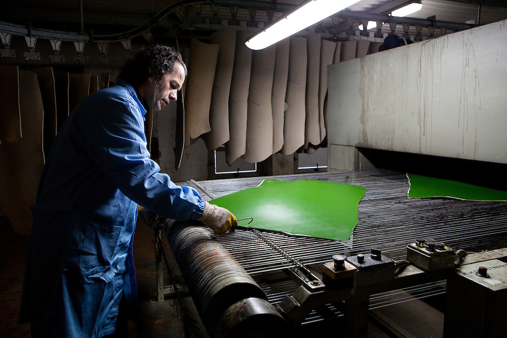 Ponte a Egola, Italy. CMC Group International Group tannery. In the finishing process, the leather is colored by skilled workers and hung for drying.