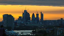 © Licensed to London News Pictures. 09/05/2017. Greenwich, UK. Sunset behind the City of London skyline as seen from Greenwich park last night (8th May). The small cruise ship Le Boreal can be seen in the foreground. Photo credit : Rob Powell/LNP