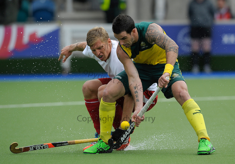 England's Ollie Willars  challenges with Australia's Kieran Govers during their semi-final at the XX Commonwealth Games, Glasgow, 2nd August 2014.