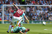 Burnley forward Ashley Barnes (10) and Arsenal defender Shkodran Mustafi (20) compete for the ball during the Premier League match between Burnley and Arsenal at Turf Moor, Burnley, England on 12 May 2019.