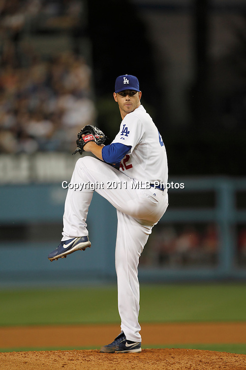 LOS ANGELES, CA - APRIL 15:  Starting pitcher Jon Garland #21 of the Los Angeles Dodgers throws a pitch during the game between the St. Louis Cardinals and the Los Angeles Dodgers on Friday April 15, 2011 at Dodger Stadium in Los Angeles, California. (Photo by Paul Spinelli/MLB Photos via Getty Images) *** Local Caption *** Jon Garland