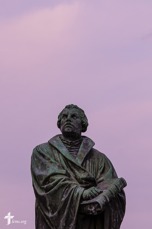 A statue of Martin Luther is painted by evening light at Concordia University, Saint Paul, on Tuesday, August 5, 2014, in St. Paul, Minn.   LCMS Communications/Erik M. Lunsford