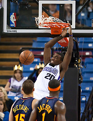 November 8, 2009; Sacramento, CA, USA;  Sacramento Kings forward Donte Greene (20) dunks in front of Golden State Warriors center Andris Biedrins (15) and forward Stephen Jackson (1) during the first quarter at the ARCO Arena. The Kings defeated the Warriors 120-107.