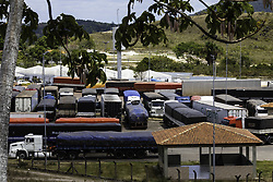May 1, 2019 - Pacaraima, Brazil - PACARAIMA, RR - 01.05.2019: CRISIS IN VENEZUELA - Freight trucks stationed in a courtyard in Pacaraima have been waiting for months to clear the border to Venezuela. (Credit Image: © JoãO Laet/Fotoarena via ZUMA Press)