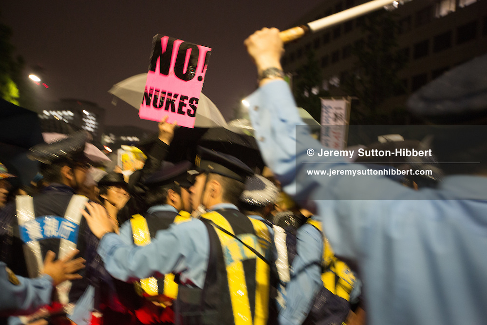 "Japanese public protest against the Japanese government's nuclear energy policies, demanding a change of energy policy, and also voice their opposition to the restarting of nuclear plants which are currently offline for safety checks, in the streets near the Japanese Prime Minister's official residence, in Tokyo, Japan, on Friday 6th July 2012. The Friday evening demonstrations,  which have been ongoing since March this year, and which in the past four weeks have grown considerably in size, are being talked of as the ""Hydrangea Revolution"" by protestors, as it is hydrangea flower season in Japan."