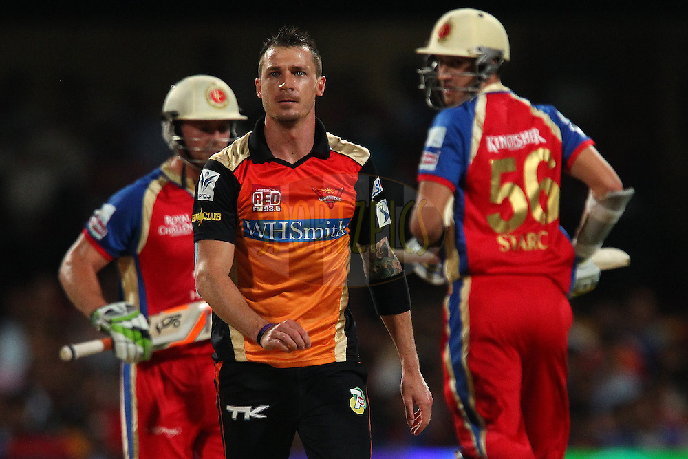Dale Steyn of the Sunrisers Hyderabad walks back as AB de Villiers of the Royal Challengers Bangalore and Mitchell Starc of the Royal Challengers Bangalore make the run during match 24 of the Pepsi Indian Premier League Season 2014 between the Royal Challengers Bangalore and the Sunrisers Hyderabad held at the M. Chinnaswamy Stadium, Bangalore, India on the 4th May  2014<br /> <br /> Photo by Ron Gaunt / IPL / SPORTZPICS<br /> <br /> <br /> <br /> Image use subject to terms and conditions which can be found here:  http://sportzpics.photoshelter.com/gallery/Pepsi-IPL-Image-terms-and-conditions/G00004VW1IVJ.gB0/C0000TScjhBM6ikg
