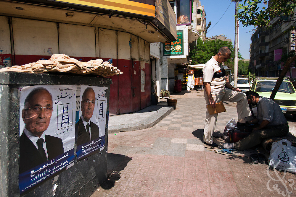 Campaign posters for former Egyptian Prime Minister Ahmed Shafik are seen under loaves of bread for sale May 15, 2012 in the Sayeda Zeinab neighborhood of Cairo, Egypt. Shafik is now running for President in the upcoming May 23-24th presidential elections across Egypt.  (Photo by Scott Nelson)