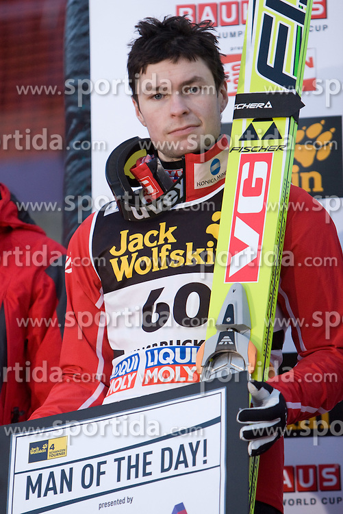 Fourth placed Andreas Kofler of Austria as Man of the day  at the medal ceremony after he competed in the Final Round of the FIS Ski Jumping World Cup event of the 58th Four Hills ski jumping tournament, on January 3, 2010 in Bergisel, Innsbruck, Austria.(Photo by Vid Ponikvar / Sportida)