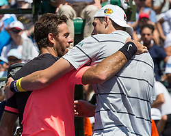 March 30, 2018 - Miami, Florida, United States - John Isner, from the USA, shake hands and hugs an exhausted Juan Martin Del Potro, from Argentina, after defeating him for the Miami Open semifinals in Key Biscayne. With his victory, Isner ends Del Potro's 15-match win streak since winning Acapulco and Indan Wells. Isner defeated Del Potro 6-1, 7-6(2)  in Miami, on March 30, 2018. (Credit Image: © Manuel Mazzanti/NurPhoto via ZUMA Press)