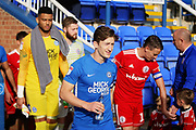 Peterborough United midfielder Alex Woodyard (4) leads the teams out  before the EFL Sky Bet League 1 match between Peterborough United and Accrington Stanley at London Road, Peterborough, England on 20 October 2018.