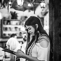 young woman writing on board in restaurant