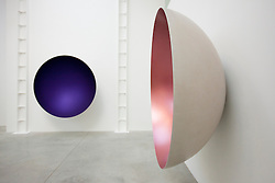 © Licensed to London News Pictures. 09/10/2012. LONDON, UK.  Anish Kapoor's sculptures 'Two Blues' (2012) (L) and 'Hollow' (2012) (R) are seen at a press view ahead of his new exhibition at the Lisson Gallery in London today (09/12/12) . The exhibition, the first since the artists solo exhibition at the Royal Academy of the Arts in 2009, features new works by Kapoor and runs from the 10th of October to the 10th of November 2012. Photo credit: Matt Cetti-Roberts/LNP