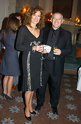 STEVEN & CAROL HOWARD at a dinner hosted by Krug champagne at Claridge's, Brooke Street, London on 14th February 2006.<br />