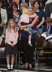 Fallen police officer Dave Phillips's wife Jen and daughters Abigail (left) and Sophie, who was killed by a teenager car thief in Wirral, Merseyside in October 2015 attending the service to commemorate National Police Memorial Day at St. Paul's cathedral in central London.