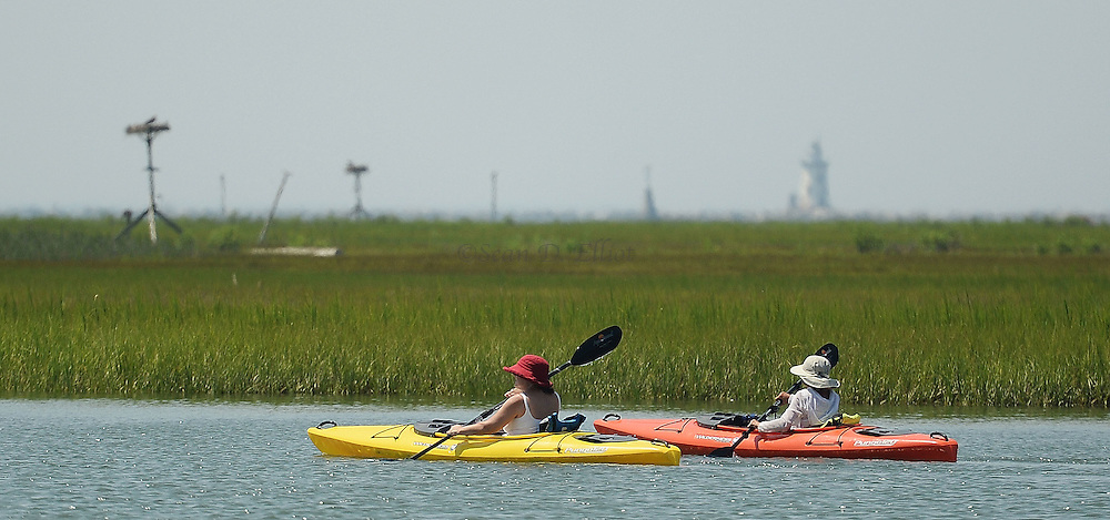 7/22/16 :: REGION :: STAND ALONE :: A pair of kayakers paddle past Great Island through the side channel of the Connecticut River by the Great Island boat ramp in Old Lyme Friday, July 22, 2016. (Sean D. Elliot/The Day)