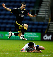 Photo: Paul Greenwood/Sportsbeat Images.<br />Preston North End v Cardiff City. Coca Cola Championship. 29/12/2007.<br />Cardiff's Tony Capaidz, (L) takes evasive action as he looses the ball to Paul Gallagher