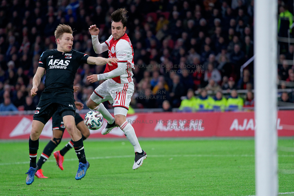 Nicolás Tagliafico #31 of Ajax and Jonas Svensson #2 of AZ Alkmaar in action during the Dutch Eredivisie match round 25 between Ajax Amsterdam and AZ Alkmaar at the Johan Cruijff Arena on March 01, 2020 in Amsterdam, Netherlands