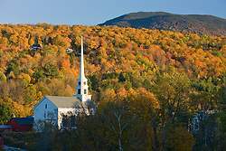 A church, and fall foliage in Stowe, Vermont.