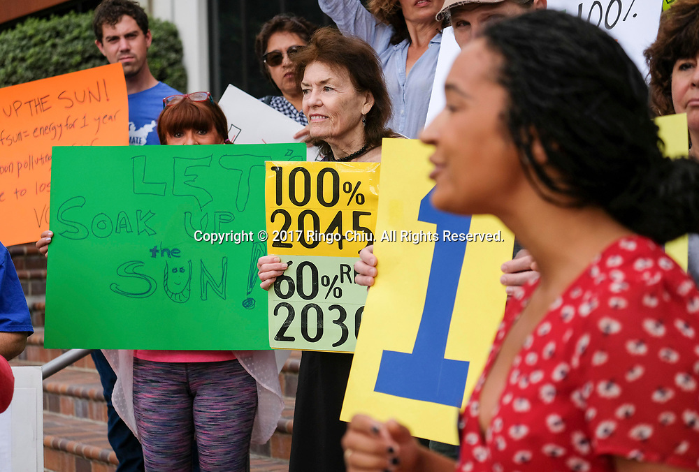 A group of environmental activists hold a rally in Pasadena, California, September 14, 2017 to press for passage of Kevin De Leon's Senate Bill 100, which they say would ensure that California generates 100 percent of its electricity from renewable and carbon-free sources by 2045.(Photo by Ringo Chiu)<br /> <br /> Usage Notes: This content is intended for editorial use only. For other uses, additional clearances may be required.