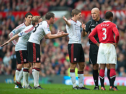 19.09.2010, Old Trafford, Manchester, ENG, PL, Manchester United vs Liverpool FC, im Bild Liverpool's Jamie Carragher and captain Steven Gerrard MBE are amazed and disgusted at referee Howard Webb's decision to only show Manchester United's John O'Shea a Yellow Card, for a foul as the last defender during the Premiership match at Old Trafford, EXPA Pictures © 2010, PhotoCredit: EXPA/ Propaganda/ D. Rawcliffe *** ATTENTION *** UK OUT! / SPORTIDA PHOTO AGENCY