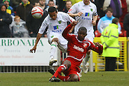 Swindon - Saturday March 20th, 2010: Korey Smith of Norwich is fouled by Swindon's Lescinel Jean-Francois during the Coca Cola League One match at The County Ground, Swindon. (Pic by Paul Chesterton/Focus Images)