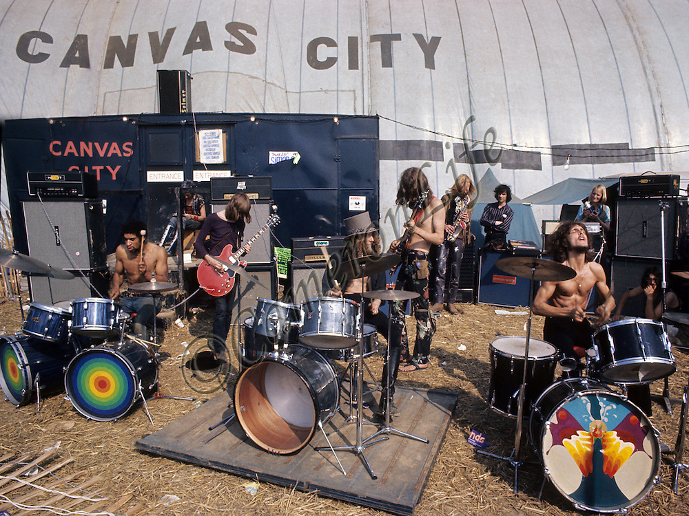 Hawkwind and The Pink Fairies outside Canvas City - Isle of Wight Music Festival 1970, by Charles Everest