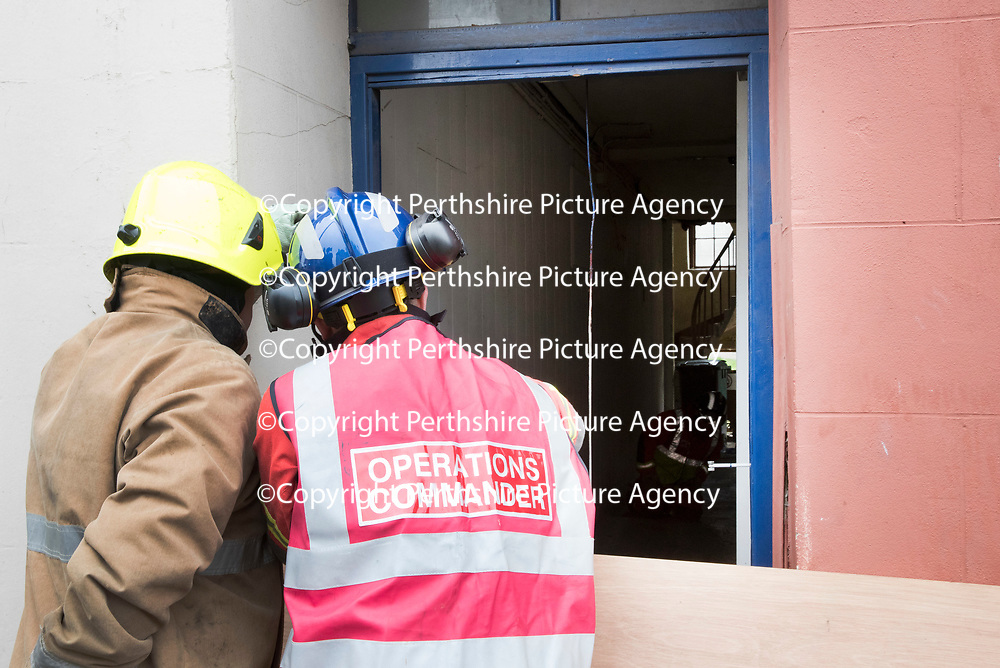 Firefighters attempting to shore up a floor in Atholl Street, Perth after a woman was injured when the floor collapsed earlier today..29.03.17 A 25 year old woman is currently being treated in Perth Royal Infirmary for minor injuries. Residents from the bloack of flats have been evacuated to allow fror a structural assessment to take place.<br />Picture by Graeme Hart.<br />Copyright Perthshire Picture Agency<br />Tel: 01738 623350  Mobile: 07990 594431