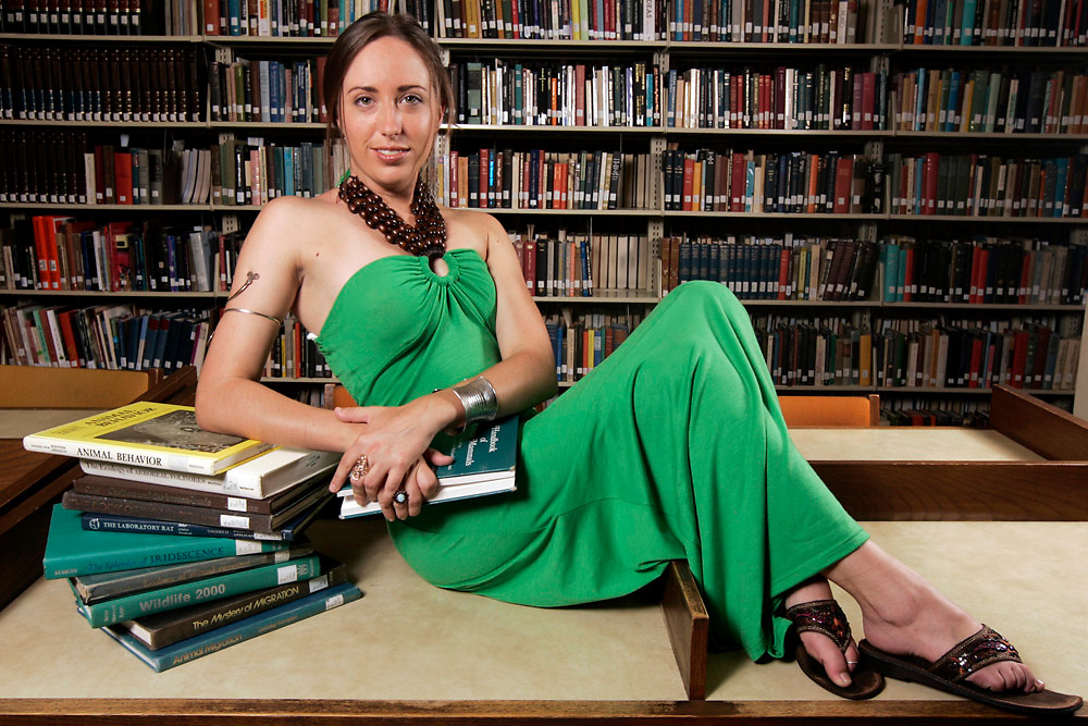 Michael Zamora/Caller-Times.Elani Morgan, a master's student at Texas A&M University-Corpus Christi, scores high marks in fashion with her green, full-length halter dress with wooden bead detail on the neck, which she wears with a pair of Montego Bay Club flats.