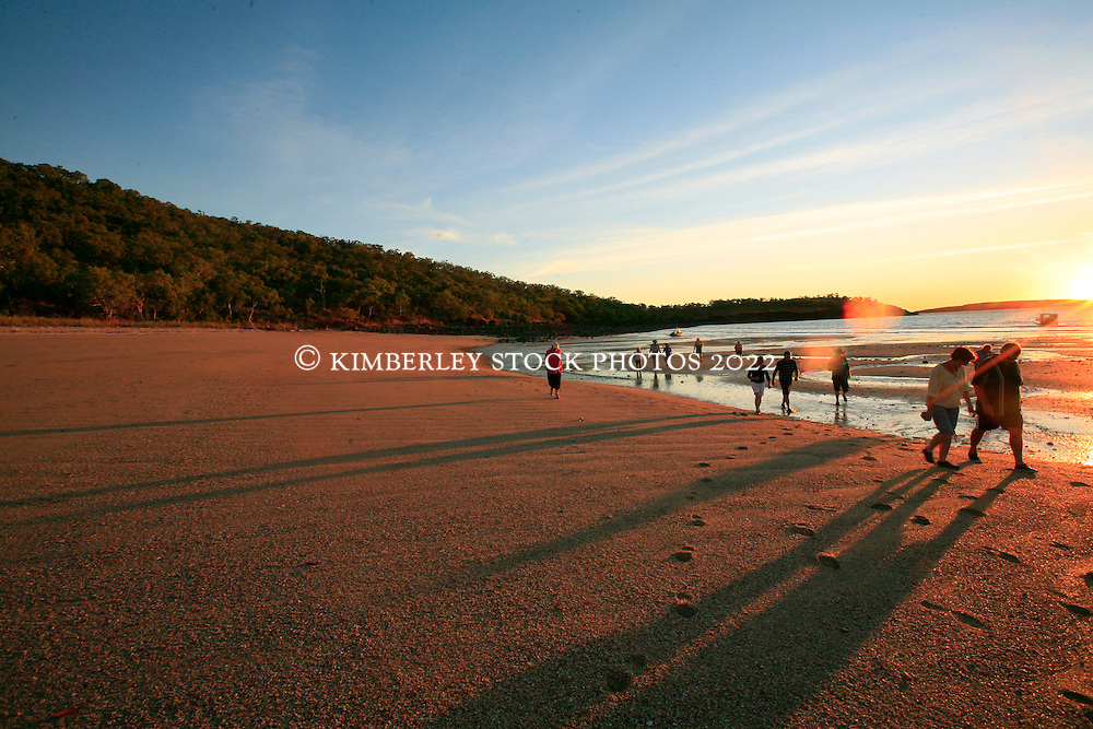 Tourists on the beach at Careening Bay on the Kimberley coast.  The famous Mermaid Tree is a short walk back from the beach.