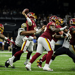 Oct 8, 2018; New Orleans, LA, USA; New Orleans Saints defensive end Marcus Davenport (92) hits Washington Redskins quarterback Alex Smith (11) as he passes during the second quarter at the Mercedes-Benz Superdome.