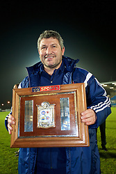 BALLYMENA, NORTHERN IRELAND - Thursday, November 20, 2014: Wales' head coach Osian Roberts with the trophy after the 2-0 victory over Northern Ireland during the Under-16's Victory Shield International match at the Ballymena Showgrounds. (Pic by David Rawcliffe/Propaganda)