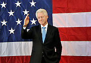 Former President Bill Clinton salutes to a crowd as he arrives at a rally for Congressman, Rep. Maurice Hinchey, D-N.Y., in Binghamton, N.Y., Monday, Oct. 11, 2010.<br /> (AP Photo/Heather Ainsworth)