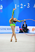"""Araujo Rita during hoop routine at the International Tournament of rhythmic gymnastics """"Città di Pesaro"""", 01 April,2016. Rita is an Portuguese individualistic gymnast, born in Almada, 2003.<br /> This tournament dedicated to the youngest athletes is at the same time of the World Cup."""