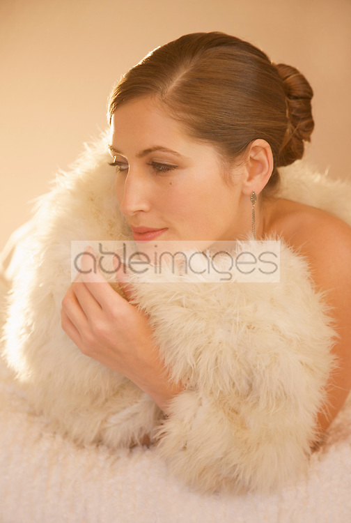 Close up of a woman wrapped in a swan feather stole
