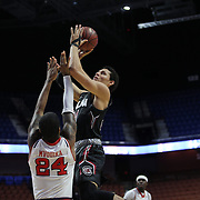 Michael Carrera, South Carolina, shoots over Ron Mvouika, St. John's, during the St. John's vs South Carolina Men's College Basketball game in the Hall of Fame Shootout Tournament at Mohegan Sun Arena, Uncasville, Connecticut, USA. 22nd December 2015. Photo Tim Clayton