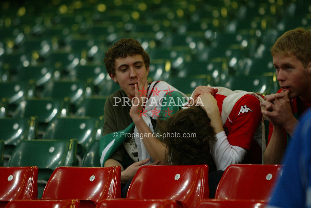 CARDIFF, WALES - Wednesday, November 19, 2003: Wales fans dejected after losing 1-0 to Russia during the Euro 2004 Qualification Play Off match at the Millennium Stadium. (Pic by David Rawcliffe/Propaganda)