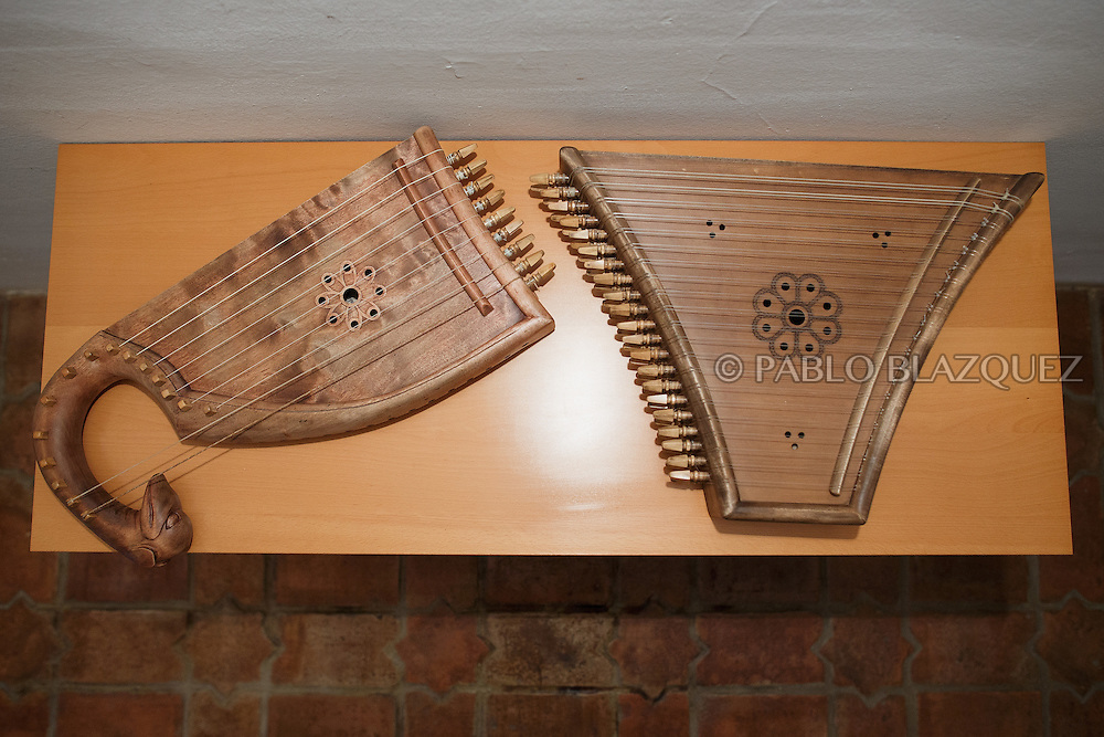 02/12/2016. Two pslateries are on display during an exhibitions of musical instruments from medieval times recently made by luthiers at the Santa María la Real de Valdeiglesias Monastery on December 2, 2016 in Pelayos de la Presa, Madrid province, Spain. The Collegiate of Santa María la Mayor is a Romanesque architecture church built during the 12th and 13th centuries. Recents restorations of the Church discovered many details on its sculptures. Then luthiers started the project 'De la piedra a la madera' to recover and to reproduce the instruments displayed on the North Gate. (© Pablo Blazquez)