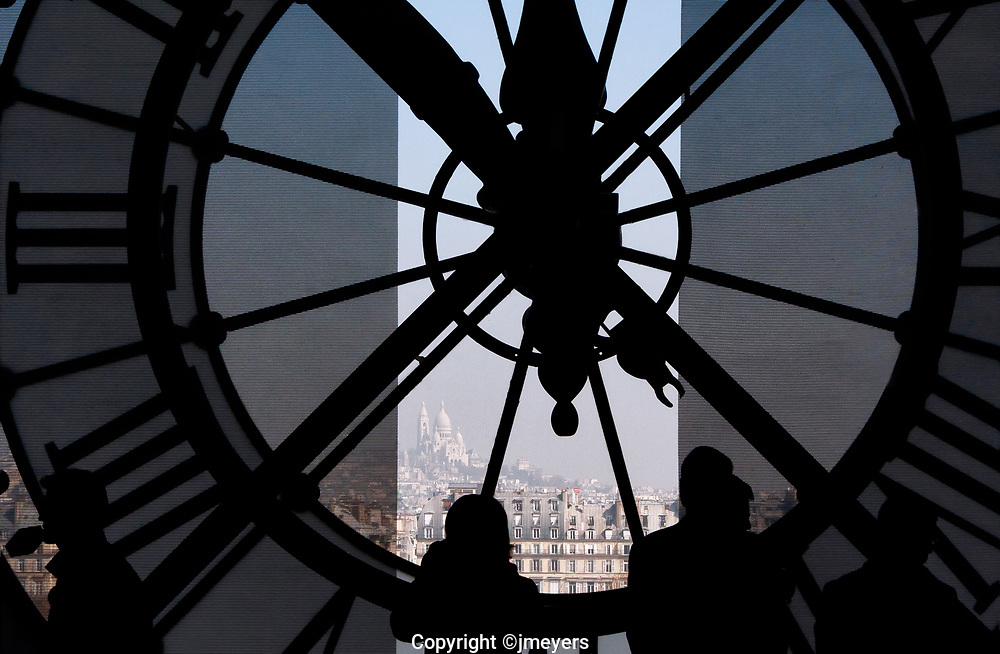 d'Orsay Clock, interior of the clock and visitors to the museum silhouetted against the view of Paris,