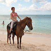 Horseback rider at Grace Bay, Providenciales, Turks & Caicos
