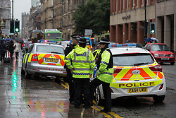 © Licensed to London News Pictures . 02/09/2015 . Manchester , UK . Police outside Manchester Magistrates' Court after protesters with antifascist flags protested outside , after protesters stormed the court . Photo credit : Joel Goodman/LNP