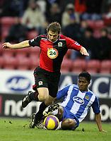 Photo: Paul Greenwood/Sportsbeat Images.<br />Wigan Athletic v Blackburn Rovers. The FA Barclays Premiership. 15/12/2007.<br />Blackburn's Stephen Warnock, (L) is challenged by Antonio Valencia