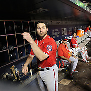 NEW YORK, NEW YORK - July 09: Daniel Murphy #20 of the Washington Nationals prepares bat in the dugout during the Washington Nationals Vs New York Mets regular season MLB game at Citi Field on July 09, 2016 in New York City. (Photo by Tim Clayton/Corbis via Getty Images)