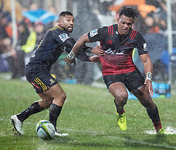 Crusaders Seta Tamanivalu, right, attempts to get to the ball before Highlanders Lima Sopoaga in the Super Rugby quarter final match, AMI Stadium, Christchurch, New Zealand, July 22 2017.  Credit:SNPA / Adam Binns ** NO ARCHIVING**