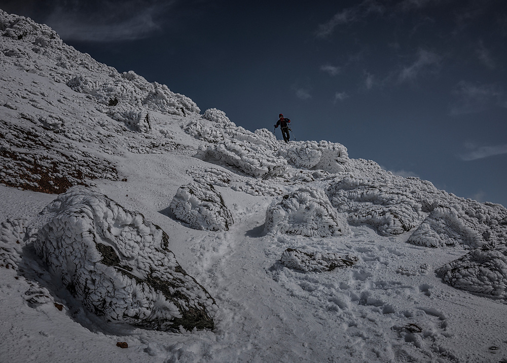 Climber descends Mt. Asahidake, the northern island of Hokkaido's highest mountain.  Yesterday, it experienced Japan's snowfall this year.  This active volcano is part of Japan's largest national park, Daisetsuzan National Park and it in the region known to be the coldest in all Japan.