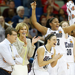 Apr 9, 2013; New Orleans, LA, USA; Connecticut Huskies players and coaches celebrate against the Louisville Cardinals during the second half of the championship game in the 2013 NCAA womens Final Four at the New Orleans Arena. Mandatory Credit: Derick E. Hingle-USA TODAY Sports