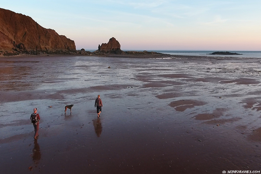 Exploring the beach at low tide in the Bay of Fundy, Five Islands Provincial Park, Nova Scotia Canada.