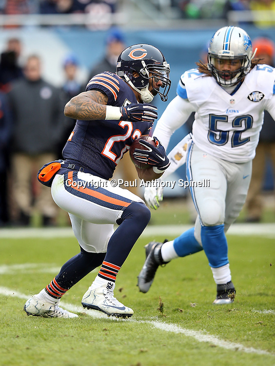 Chicago Bears running back Matt Forte (22) makes a cut away from Detroit Lions defensive end Darryl Tapp (52) as he runs the ball in the first quarter during the NFL week 17 regular season football game against the Detroit Lions on Sunday, Jan. 3, 2016 in Chicago. The Lions won the game 24-20. (©Paul Anthony Spinelli)