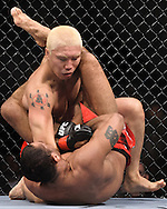"ATLANTA, GEORGIA, SEPTEMBER 6, 2008: Ryo Chonan (facing) tries to work out from the guard of Roan Carneiro during ""UFC 88: Breakthrough"" inside Philips Arena in Atlanta, Georgia on September 6, 2008"