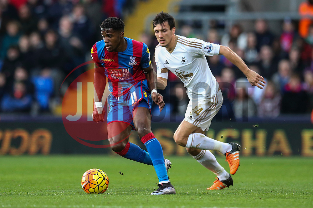 Wilfried Zaha of Crystal Palace under pressure from Jack Cork of Swansea City - Mandatory byline: Jason Brown/JMP - 07966386802 - 28/12/2015 - FOOTBALL - London - Selhurst Park - Crystal Palace v Swansea City - Barclays Premier League