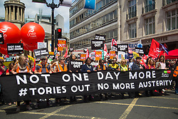 London, July 1st 2017. Anti-Tory protesters march from the BBC's headquarters through the streets of London to Parliament in London following the Conservative Party's £1.5 billion deal with the DUP to enable a slim majority in the House of Commons. PICTURED: Labour's Diane Abbott MP, front row, centre, joins activists at the head of the march.